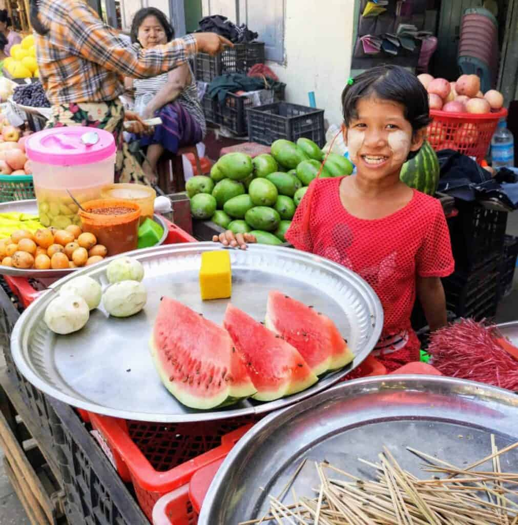 Girl Selling Fruit at the Market