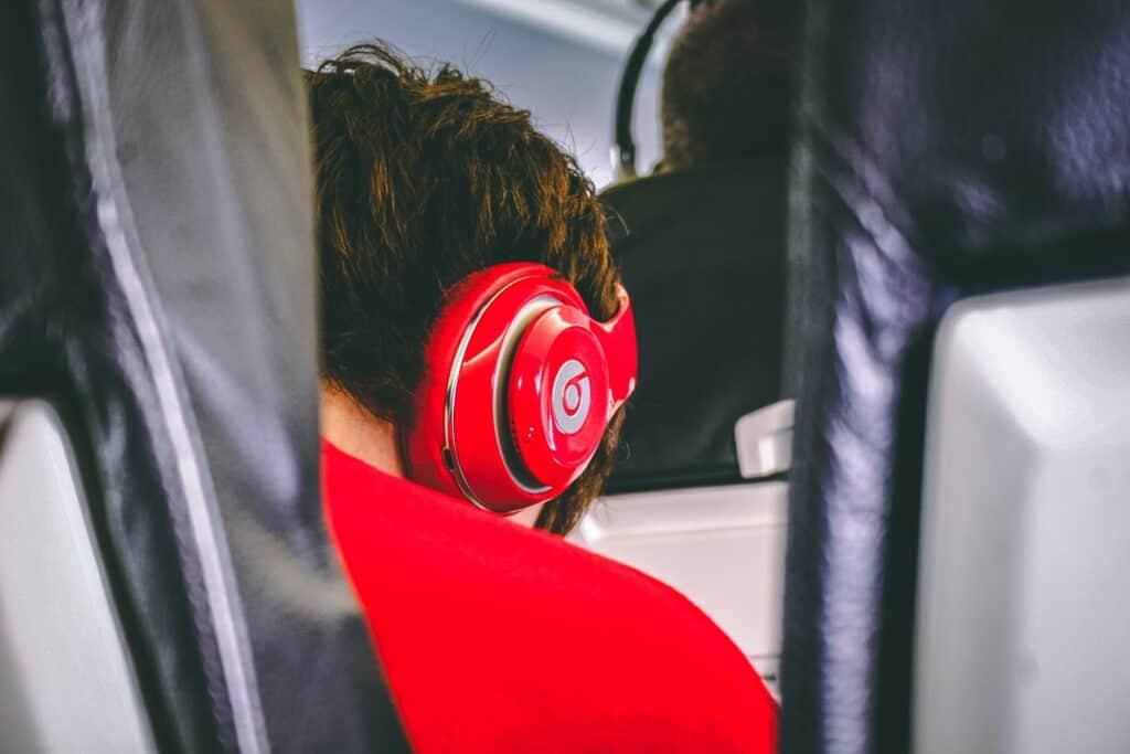 Teenager on plane wearing headphones