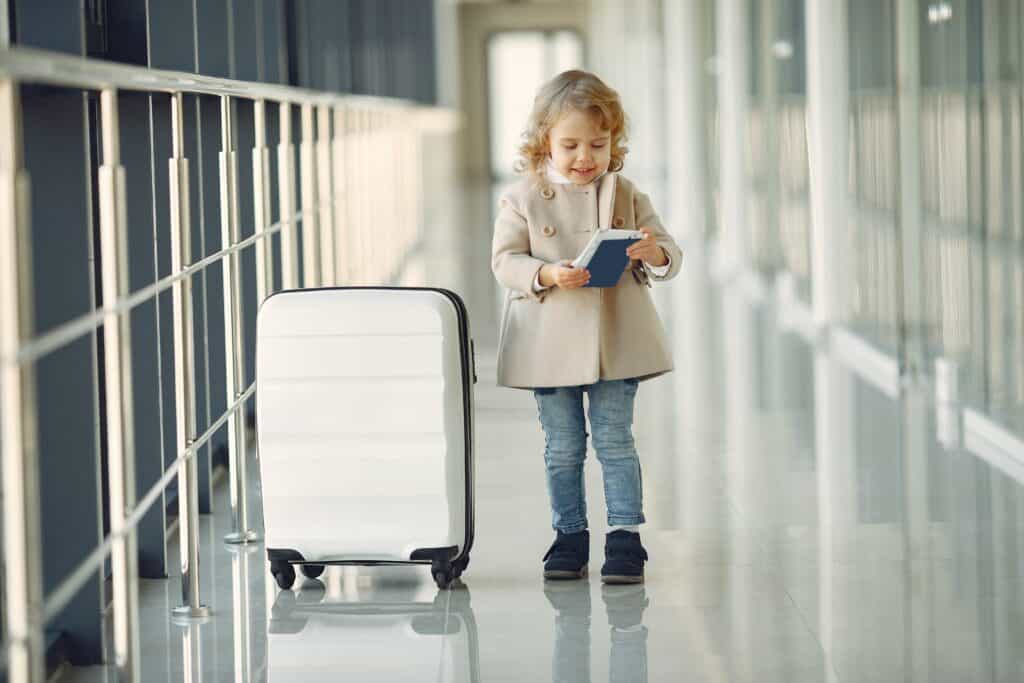 Child with passport at airport